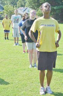 CHS marching band members, from back to front, Ricky Smith-Cecil, Anthony Drew, Lauren Rinehart, Crystal Ratliff and Taneisha Noyola march during camp on Tuesday.