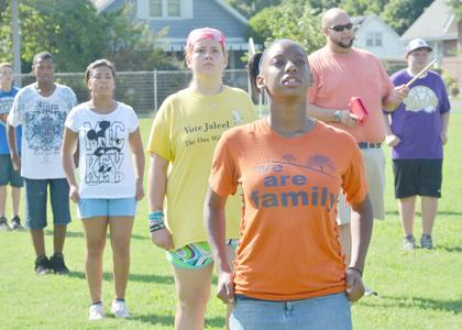 CHS director of bands Zach Shelton, at right, instructs his marching band members during a drill at band camp on Tuesday.
