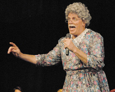 "Ed Pavy, director of campus ministries at CU from Campbellsville, performs ""You Can't Stop the Beat"" while dressed as a woman."