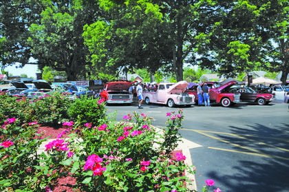 Spectators check out the cars on display at the annual car show at Campbellsville University.
