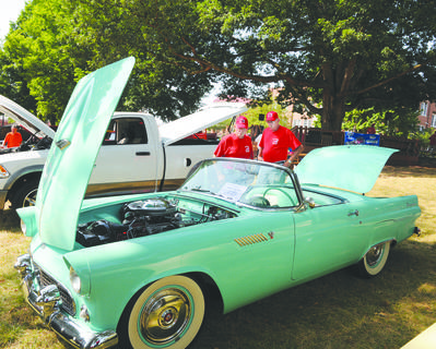 Al Hardin, at left, president of the Tri-County Car Club, and Mike Riggs, judge cars at the annual car show at Campbellsville University. The club has hosted the car show for many years.