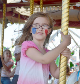 Eden Doerr of Campbellsville enjoys a ride on the carousel at the Taylor County Fair.
