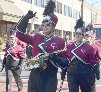 Daniel Beams of Campbellsville plays the alto saxophone with the CU Tiger Marching Band during Saturday's Homecoming parade. The band is celebrating its 20th anniversary.