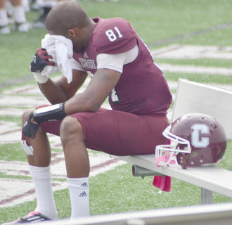 CU football player Steph'Von Haynes rests after playing in Saturday's Homecoming game. The Tigers won the game 28-23.