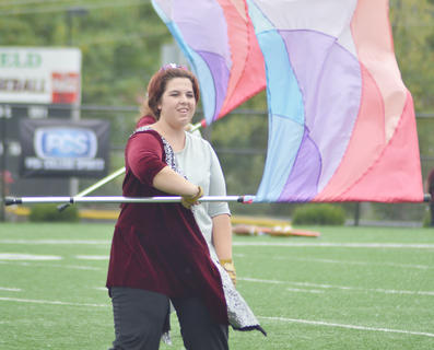 Krissy Darby of Petersburg performs with the CU Tiger Marching Band during Saturday's Homecoming half-time show. The band is celebrating its 20th anniversary.