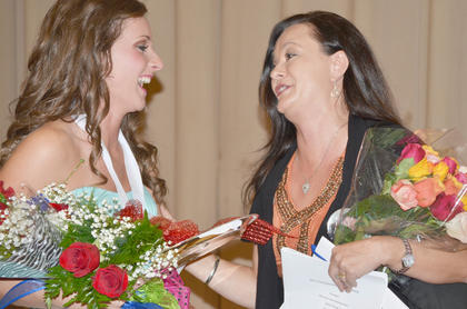 Brittany Salmon was named Taylor County's 2013 Distinguished Young Woman on Saturday night. At right, Salmon's aunt, Angie Graham, congratulates her.