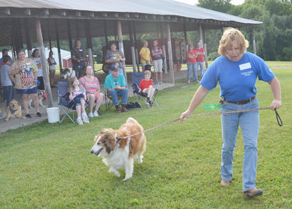 Shellie Kendall shows off her dog, Sable, at the fair's first dog show, sponsored by the Taylor County SPCA.
