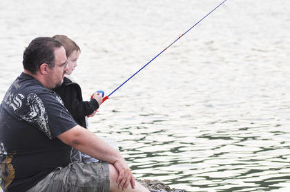 Dominic Pearlman, 6, gets encouragement from his dad Justin at City Lake.