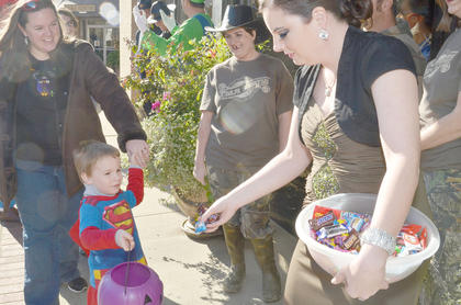 Citizens Bank and Trust Co. employees pass out candy to trick-or-treaters but also dress in costumes, from the Turtleman and witches and more.