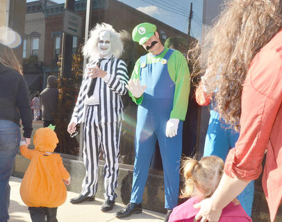 Citizens Bank and Trust Co. employees pass out candy to trick-or-treaters but also dress in costumes, from Mario and Luigi to Bettlejuice and more.