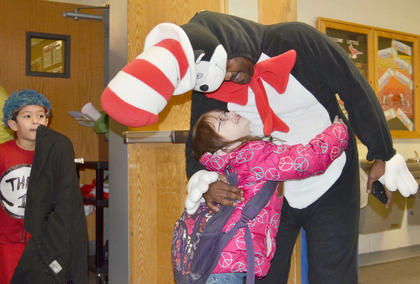 Students at TCES give The Cat in the Hat a high-five.