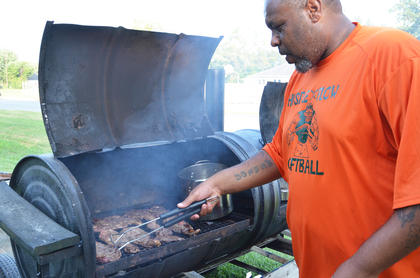 Marlon Hoskins of Campbellsville mans the grill at the food court.