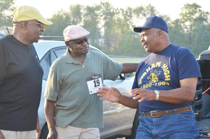 Brothers-in-law James Davis of Atlanta, Ga., and Jimmy Tucker and Clem Haskins of Campbellsville talk before the race.
