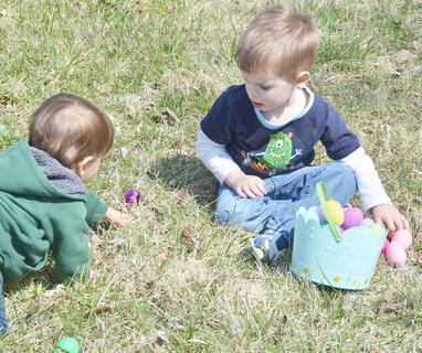 Zephaniah Dye, 13 months old, of Campbellsville, searches for Easter eggs with Caleb Watkins, 3, of Campbellsville, at a home in Holly Brook Subdivision.