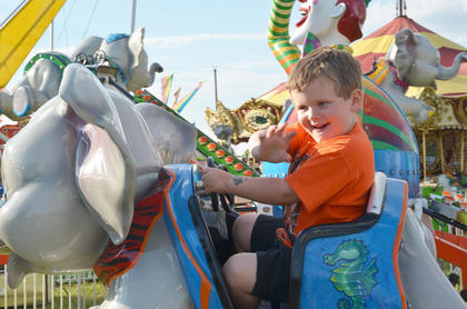 Jayden Hardin of Campbellsville waves to his parents from an elephant ride.