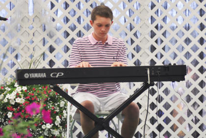 Samuel Kessler performs the winning act on the piano at the Coca-Cola Talent Classic.