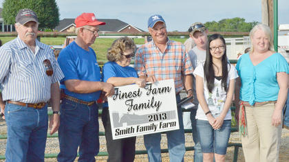 Barry Smith, fourth from left, and his family receive the fair's Finest Farm Family award.