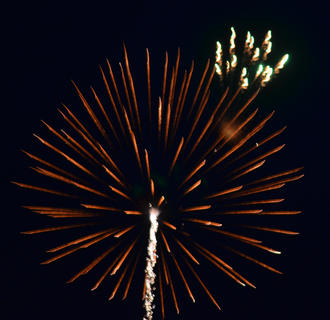 The annual Fourth of July fireworks show lights up the night sky on Friday, July 12. The show was postponed from Thursday, July 4, because of rain.