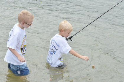 Cotten Gravel, at left, and Isaac Courtwright of Campbellsville take their turn fishing in Green River Lake.