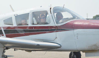 Cole Price and Sherri Price of Campbellsville take a ride in an airplane.