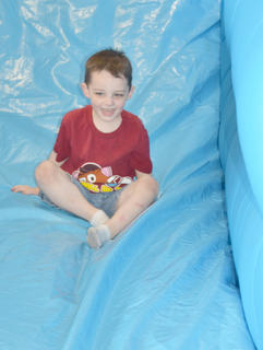 John Zottman of Campbellsville takes a turn on an inflatable slide.