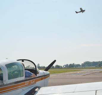 Billy Joe Cave of Campbellsville straps himself in for a plane ride with his grandsons as another plane flies overhead.