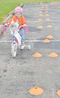 Sarah Conn, 2, of Columbia, drives through the obstacle course.