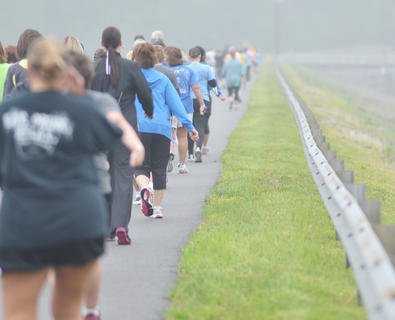 Walkers make their way to Green River Lake's dam on Saturday.