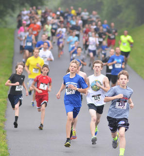 Runners get an early lead in the annual I'm a Dam Runner 5K run and walk hosted by Friends of Green River Lake.
