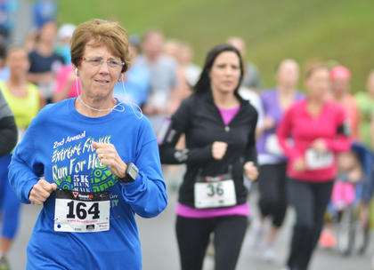 Johanna Compton listens to music as she runs. She came in second in her age category.