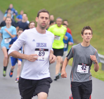 Joel Hughes, at right, runs in Saturday's race. He came in fifth in his age category. At left is Billy Dengel.