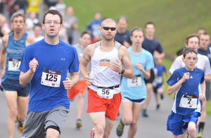 Scott Blakeman, at left, of Campbellsville, leads a pack of runners on Saturday.