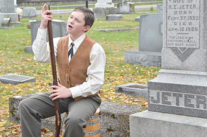 Samuel Kessler tells visitors about his life as he portrays the ghost of Rodophil E. Jeter.