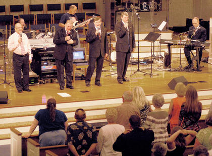 Three groups performed at this year's annual gospel singing on Saturday. Above, the Garry Polston Family sings a favorite gospel hymn.