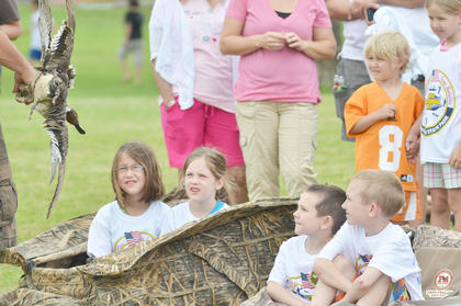 Area children learn about hunting and how to call for animals.