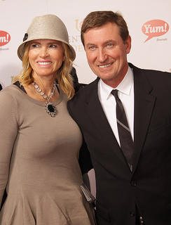 Hockey legend Wayne Gretzky and his wife, Janet, pose for a photo as they entered Saturday's Kentucky Derby.