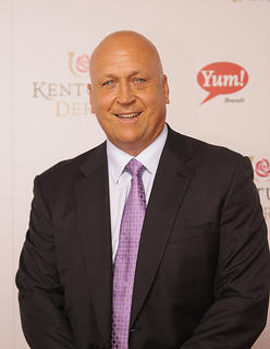 Baseball legend Cal Ripken Jr. poses for a photo on the red carpet.