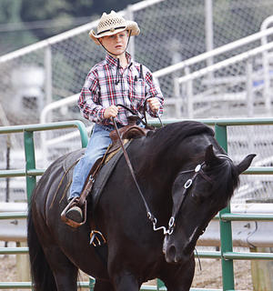 Chase Morris, 6, of Campbellsville, rides his horse, Two Socks, during the Youth Horse Show on Saturday.
