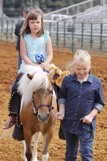 Samantha Akridge, 4, rides Cheyanne, while Breanna Sharp, 9, leads the horse during the Youth Horse Show on Saturday. Both girls are from Campbellsville.