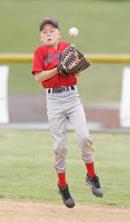 Cole Wright of the Red Sox gets a bad hop from a ground ball during pee wee action.