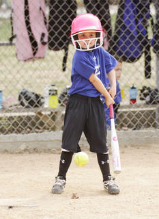 Haley England swings at a pitch at Trace Creek Saturday in softball action.