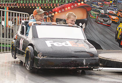 Children enjoyed rides in a racecar on Monday night, courtesy of Myers International Midway.