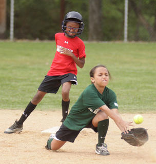 Briante Gowdy of the Cardinals steals second base as Jada Taylor of the Lady Shockers fields the throw in softball action at Trace Creek.