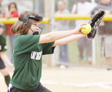 Mackenzie Sprowles of the Lady Shockers delivers a pitch against the Cardinals Saturday at Trace Creek.