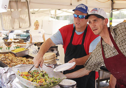 Food vendors serve all sorts of dishes to those attending the parade and Fourth of July festivities.