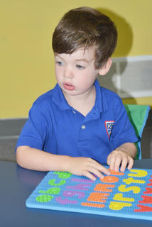 Kentucky Christian Academy students headed back to class on Tuesday, Aug. 2, after summer break. Campbell Parsons, a student in the Sonbeams class, works on an ABCs puzzle.