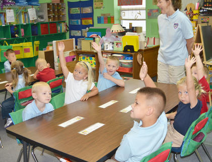 Faith Wade, a preschool teacher aid, talks to KCA's preschool class about the correct way to have a conversation with people.