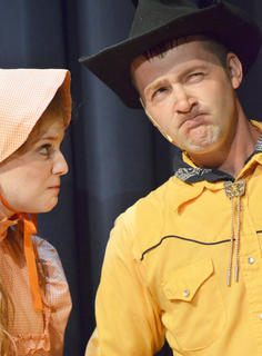 Will Parker, portrayed by Chad Shively of Campbellsville, shows his frustration with his love, Ado Annie, played by Carrie Fowler.