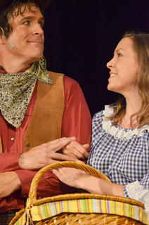 Bethany Shively of Campbellsville, at right, portrays Gertie Cummings, and embraces Curly, played by G.B. Dixon.