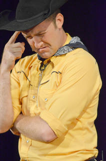 Chad Shively of Campbellsville portrays Will Parker, who competed to win $50 so he could marry his long-time love, Ado Annie, played by Carrie Fowler. But Will found some trouble along the way and nearly lost his girl. Here, Will tries to add up how much money he has.